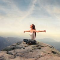 woman-on-top-of-mountain